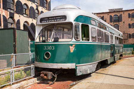 gentrification: Brooklyn, New York, USA - June 5, 2015: View of antique trolley car on the waterfront of Red Hook Brooklyn in New York City. Editorial