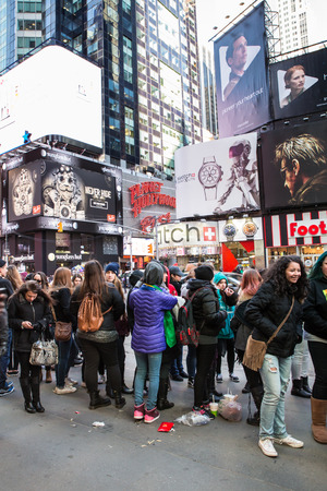 New York City, New York, USA - March 23, 2015: Fans wait on line to see Fifth Harmony concert in Times Square midtown Manhattan.