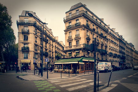 Paris, France - October 9, 2014: Quaint street scene with people visible taken in Paris France 新闻类图片