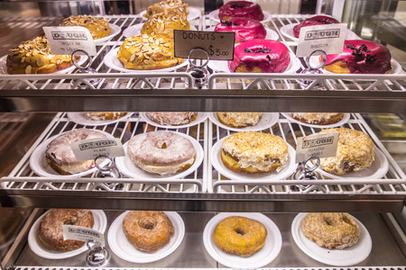 Variety of gourmet donuts in bakery case