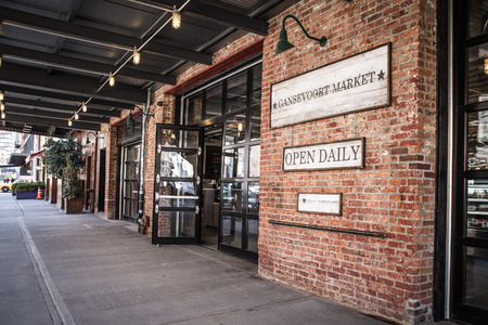 New York City, New York, USA  - March 13, 2015: Street view of landmark Gavsevoort specialty food market in the Meatpacking District in Manhattan. Editorial