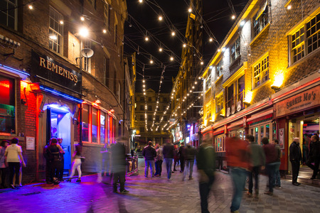LIVERPOOL, UNITED KINGDOM - OCTOBER 11, 2014: Night scene alone historic Matthew Street in Liverpool with people visible.