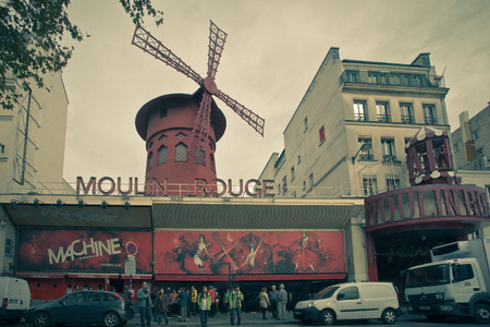 moulin: PARIS, FRANCE - OCTOBER 9, 2014:  Moulin Rouge from the street with vintage filter effect