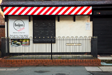 barber: LIVERPOOL, UNITED KINGDOM - OCTOBER 12, 2014: Landmark Penny Lane Barber Shop in Liverpool made famous by The Beatles Editorial