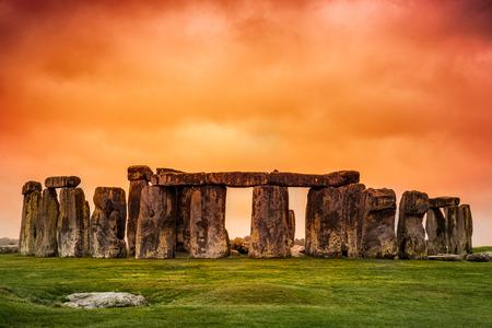 orange sunset: Stonehenge against fiery orange sunset sky
