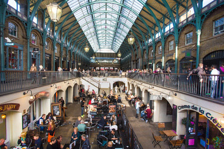 crowded: LONDON, UNITED KINGDOM - OCTOBER 10, 2014: View of The Market Building at Covent Garden in London. Editorial