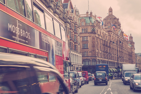 harrods: LONDON, UNITED KINGDOM - OCTOBER 8, 2014: Vintage style street view of London along busy Brompton Road in London with Harrods and iconic double decker bus.