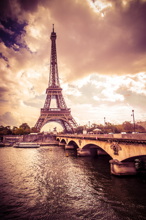 Eiffel Tower: Beautiful Eiffel Tower in Paris France under golden light Stock Photo