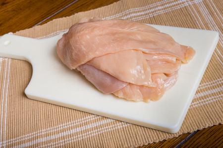 Thin sliced chicken breast cutlets Stock fotó