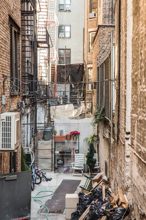 dark alley: Typical alley between buildings in New York City Stock Photo