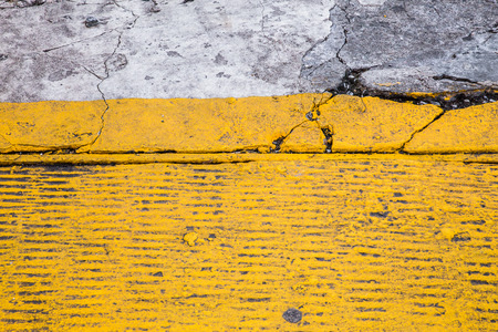 yellow line: Cracked painted yellow street backdrop texture