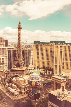 sin city: LAS VEGAS, NV - MAY 7, 2014: Pictured here is a view across Las Vegas strip with Paris Las Vegas Resort view. This image has a retro filter effect.
