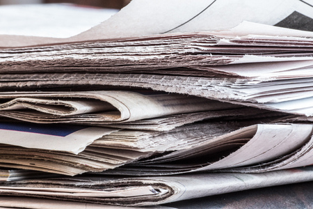 Extreme closeup of stack of newspapers