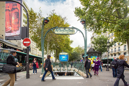 subway entrance: PARIS, FRANCE - OCTOBER 9, 2014: Picture here is a Metro subway entrance street scene in Paris, France with many people visible.