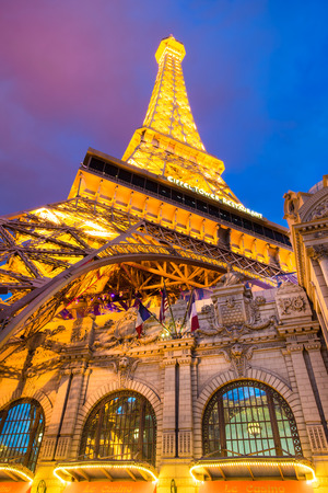 sin city: LAS VEGAS, NEVADA - MAY 7, 2014: View of the Eiffel Tower at Paris Hotel and Casino in Las Vegas, Nevada as seen lit up at after sunset.