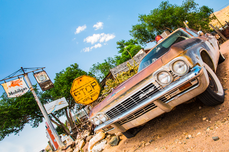 general store: HACKBERRY, ARIZONA - MAY 8, 2014: Vintage Mercury automobile at roadside antiques store along Route 66.