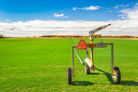 irrigation equipment: Sod farm with sprinkler irrigation equipment on a sunny day Stock Photo