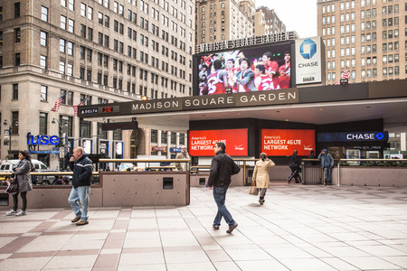madison: NEW YORK CITY - OCTOBER 25, 2013: Exterior view of Madison Square Garden in midtown Manhattan with people visible.