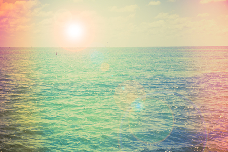 sun flare: Vintage color photograph style of tropical ocean with sun flare Stock Photo
