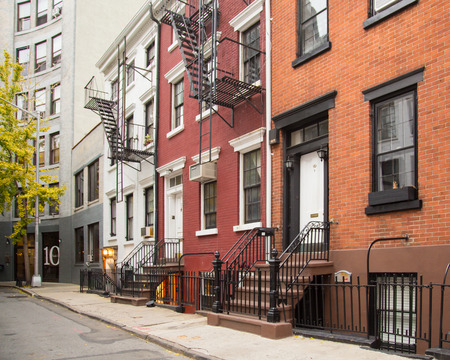NEW YORK CITY - NOVEMBER 9, 2013: Exterior view of homes along quaint street in Manhattan's West Village.