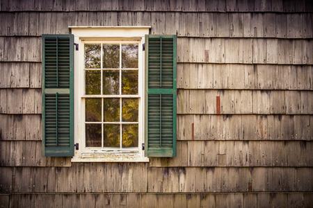 barnwood: window and shutters on wood shingled home