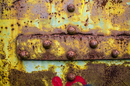 Rusty corroded details on painted steel door