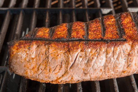 London Broil cut of beef steak on barbecue grill cooking