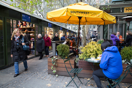 bryant: NEW YORK CITY- NOVEMBER 16, 2014: View of holiday boutiques at historic Bryant Park in Midtown Manhattan with people in the scene