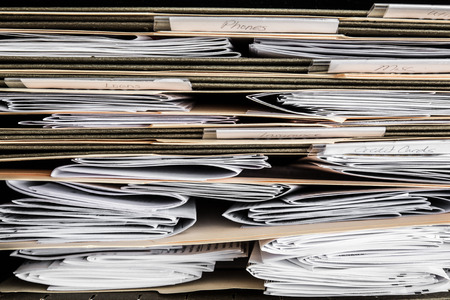 statements: Stack of papers, bills, invoices and financial statements in files Stock Photo