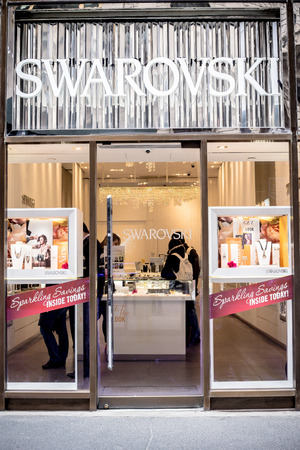 fifth avenue: NEW YORK CITY - MARCH 14, 2014: Exterior window view of Swarovski Crystal store along fashionable Fifth Avenue in midtown Manhattan.