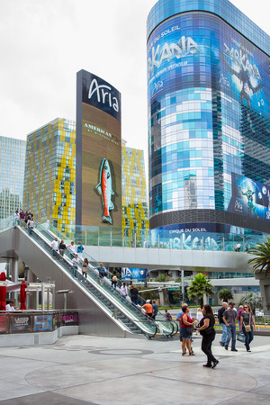 sin city: Las Vegas, Nevada, USA - May 7, 2014: Street scene along Las Vegas Boulevard at the Aria Resort Casino with escalator and people in view.