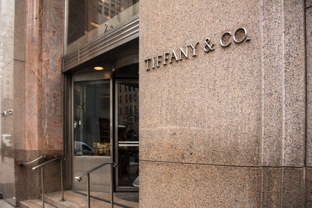 fifth: NEW YORK CITY - MARCH 14, 2014: Exterior view of Tiffany & Co., along fashionable Fifth Avenue in Manhattan.