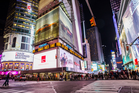 New York City, New York, USA - September 14, 2015:   Night view of world famous Times Square in midtown Manhattan with people, lights and signs.