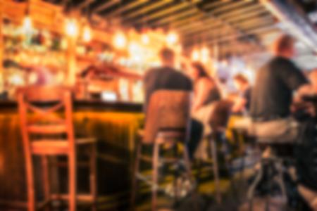 Defocused pub blur with people at the bar