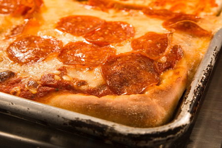 Delicious authentic New York style Sicilian pizza with pepperoni in pan
