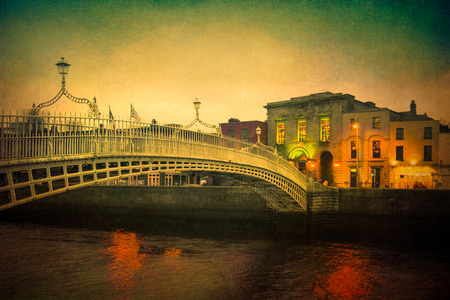 Vintage textured image of Dublin Ireland at Ha'penny bridge over the River Liffey