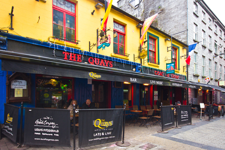 Galway, Ireland - March 31, 2013: Street scene in the historic city of Galway Ireland with people visible.