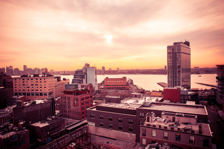 Sunset view of west side of New York City from Manhattan Chelsea and Meatpacking district toward New Jersey at sunset