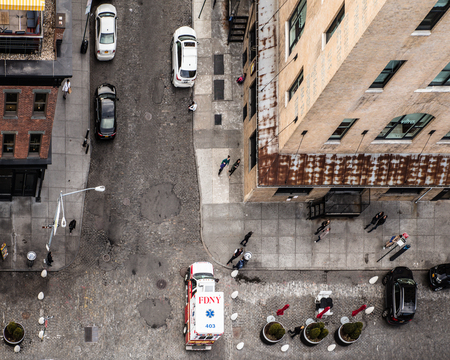 top down car: Manhattan view from above looking downward to the city street below with cars, ambulance, and  people. This photo is from the Meatpacking Gavesvoort district. Editorial