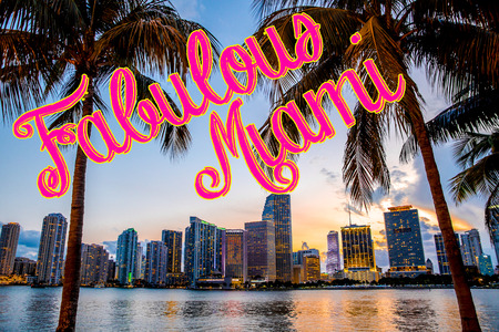 Travel poster style of Beautiful city of Miami Florida skyline seen through tropical palm trees with the words Fabulous Miami Stock Photo