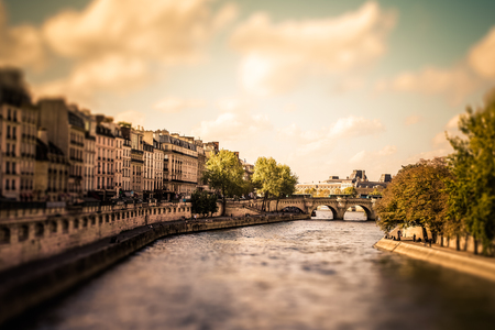 Tilt-shift miniature view of the River Seine from Paris with vintage filter effect