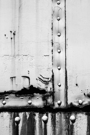 rivets: Black and white industrial texture with rust and rivets