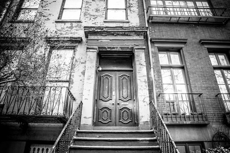 multifamily: Typical Entrance door to a New York City apartment building residential home