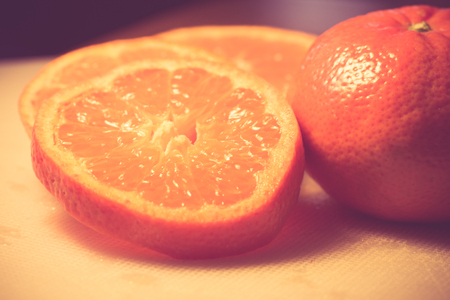 Ripe orange and slices with vintage retro filter