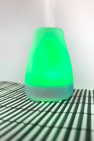 Colorful lit essential oil diffuser with mist