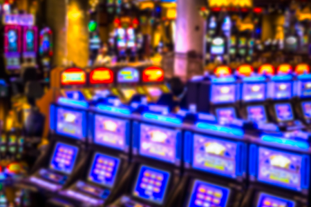 Defocused blur of slot machines in casino