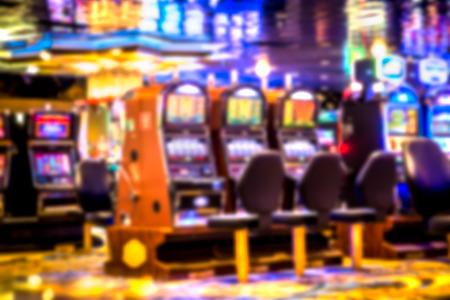 machines: Defocused blur of slot machines in casino