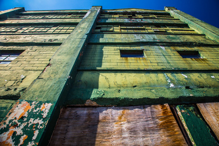 empty warehouse: Grungy industrial factory building abandoned Stock Photo