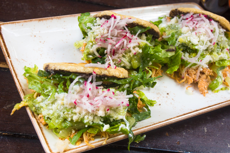 Mexican cuisine of chicken tostada with guacamole