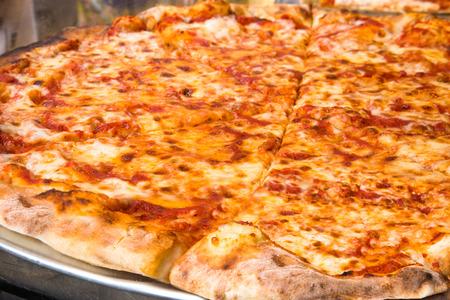 Authentic New York City Italian style pizzeria pizza pie 免版税图像 - 86676739